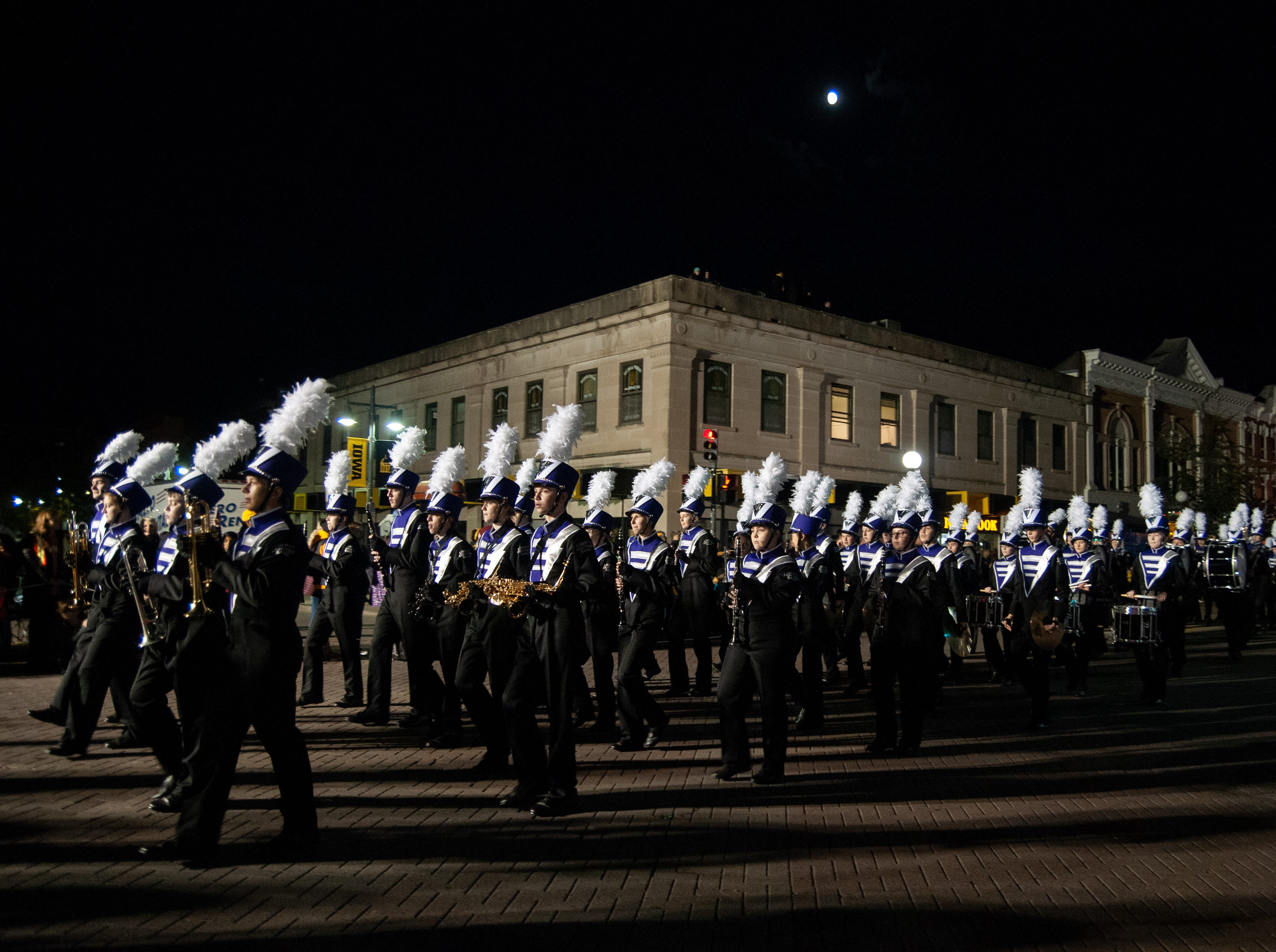 The Liberty High Marching Band performs during the 2018 Homecoming parade, Friday, Oct. 19, 2018, in Iowa City.