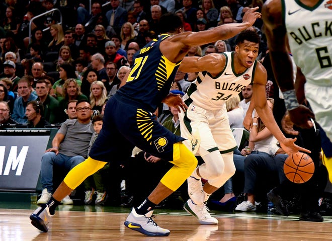 Oct 19, 2018; Milwaukee, WI, USA; Milwaukee Bucks forward Giannis Antetokounmpo (34) drives against Indiana Pacers forward Thaddeus Young (21) during the first half at Fiserv Forum. Mandatory Credit: Matt Marton-USA TODAY Sports