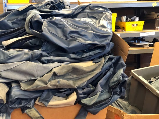 Amtrak sends PUP boxes of leather cut from train seats that PUP will clean, trim and sew into bags.