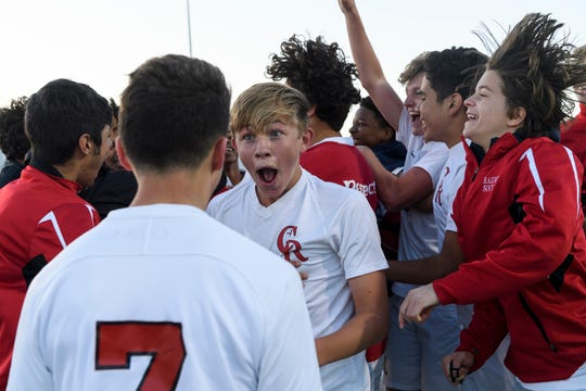 The Indianapolis Cardinal Ritter Raiders celebrate their 1-0 victory over the Washington Hatchets in the IHSAA Class 2A semistate match at Bundrant Stadium in Evansville, Ind., Saturday, Oct. 20, 2018. The Raiders stunned the Hatchets by scoring a goal with 21 seconds left on the game clock.
