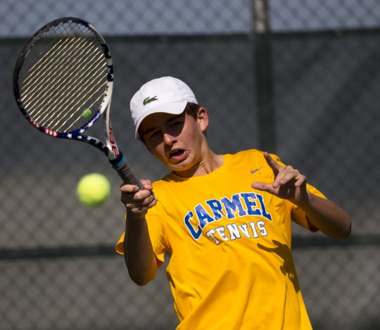 FILE – Carmel's Presley Thieneman scored a 6-0, 6-0 win to claim the IHSAA boys singles state championship on Saturday.