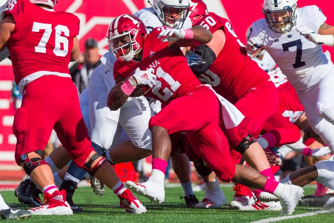 Indiana running back Stevie Scott (21) rushes the ball out of the backfield during the first half of an NCAA college football game against Penn State Saturday, Oct. 20, 2018, in Bloomington, Ind. (AP Photo/Doug McSchooler)