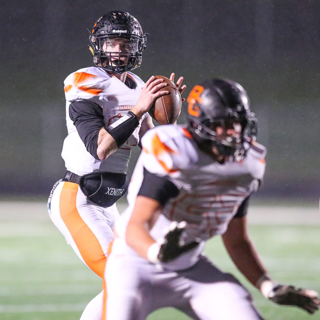 Beech Grove Hornets quarterback Jordan Reel (10) looks downfield against the Mooresville Pioneers at Mooresville High School on Friday, Oct. 19, 2018.