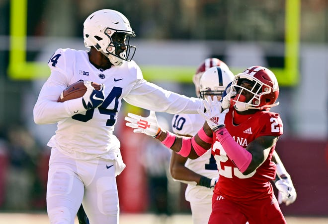 Penn State Nittany Lions wide receiver Juwan Johnson (84) attempts to void tackle by Indiana Hoosiers defensive back Jaylin Williams (23) with the ball during the second quarter of the game at Memorial Stadium .