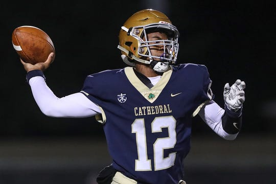 Cathedral Fighting Irish quarterback Orin Edwards (12) drops back to pass during the second half of sectionals at Southport High School in Indianapolis, Friday, Oct. 19, 2018. Cathedral won, 51-14.