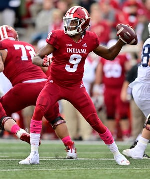 Indiana Hoosiers quarterback Michael Penix Jr. (9) throws a pass during the second quarter of the game against the Penn State Nittany Lions at Memorial Stadium .