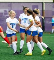 The Carmel Greyhounds celebrate during their IHSAA 3A semistate soccer match against the Center Grove Trojans at Seymour High School in Seymour, Ind., on Saturday, Oct. 20, 2018.