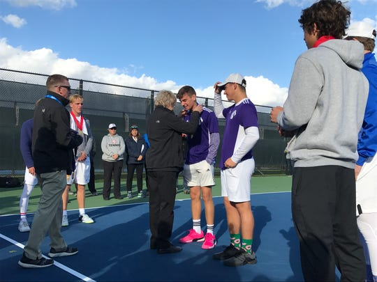 Leo pair of Eli Herran and Isaac Steiner receive their state title medals Saturday at Park Tudor.