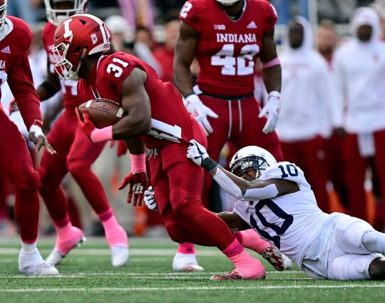 Penn State Nittany Lions wide receiver Brandon Polk (10) attempts to take down Indiana Hoosiers defensive back Bryant Fitzgerald (31) during the second quarter of the game against the Indiana Hoosiers at Memorial Stadium .