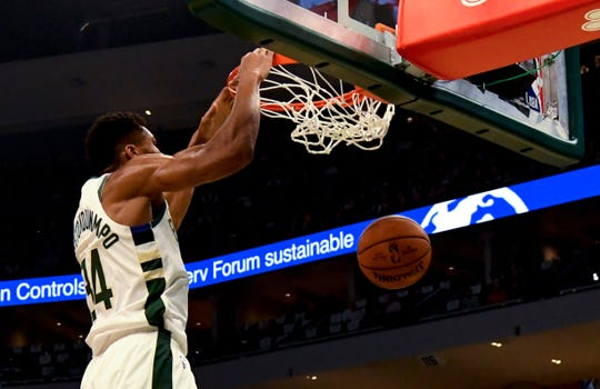 Milwaukee Bucks forward Giannis Antetokounmpo (34) dunks the ball against Indiana Pacers during the first half at Fiserv Forum.