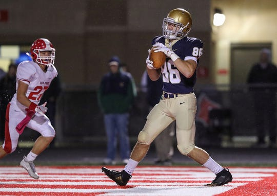 Cathedral Fighting Irish tight end Haven Montefalco (86) receives the ball in the end zone for an Irish touchdown during the first half of sectionals at Southport High School in Indianapolis, Friday, Oct. 19, 2018. Cathedral won, 51-14.