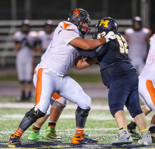 Beech Grove Hornets' Josh Fryar (70) blocks against Mooresville Pioneers' Robert Gentry (62) at Mooresville High School on Friday, Oct. 19, 2018.