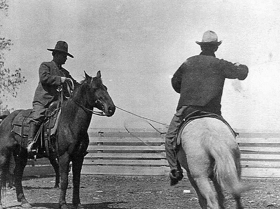This around 1910 photo provided by Francine Locke Bray shows Victor Locke Sr., left, with an unknown cowboy on Choctaw horses in Pushmataha County, Okla. An aging stallion found by accident on a Mississippi farm is bringing the first new blood in a century for a line of horses brought to America by Spanish conquistadors and bred by Choctaw Indians who were later forced out of their ancestral homelands. (Francine Locke Bray via AP)
