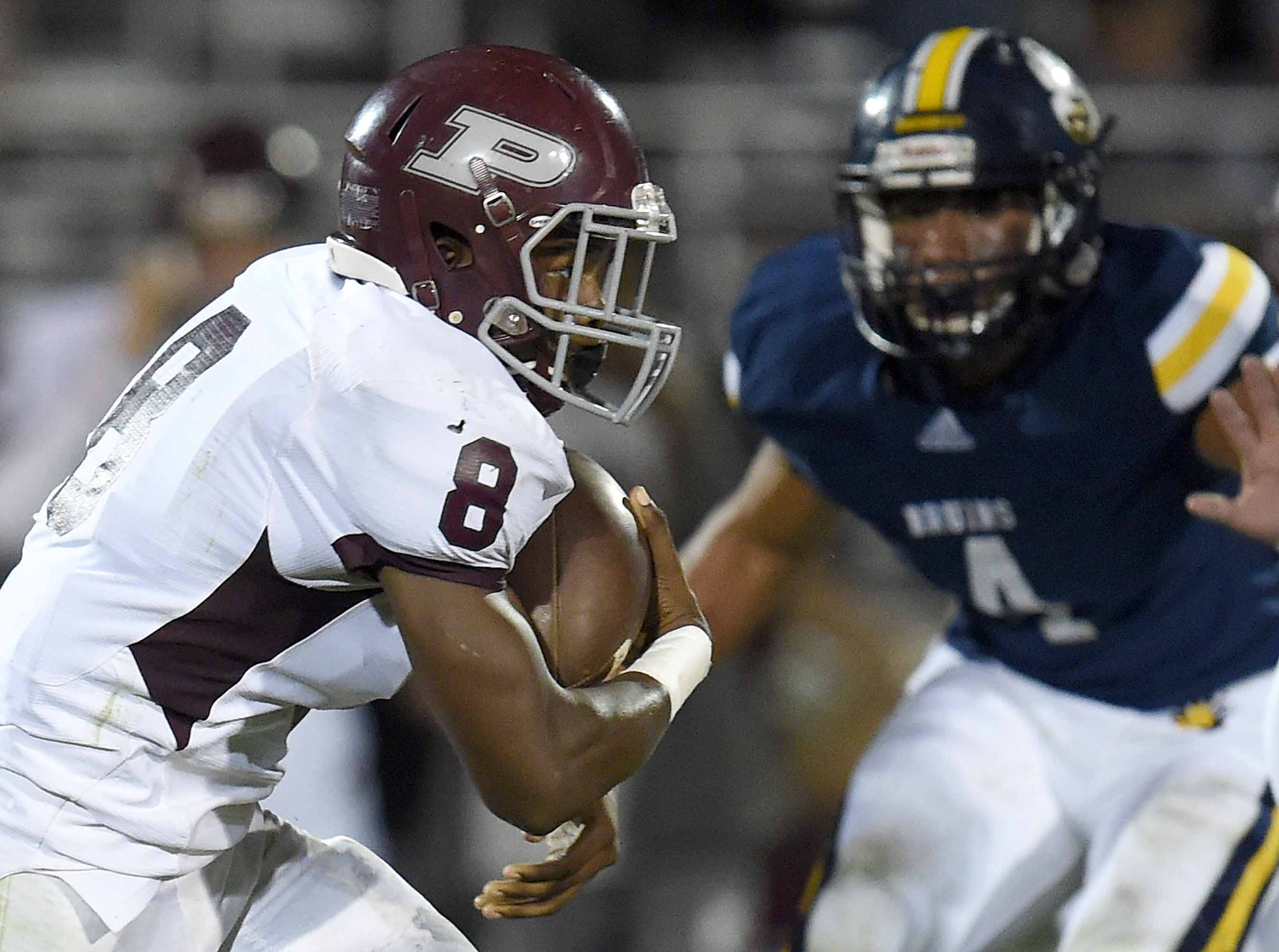 Puckett's Omar Easterling (8) tries to get by St. Joseph's Stephen Wolf (4) on Friday, October 19, 2018, at St. Joseph Catholic School in Madison, Miss.