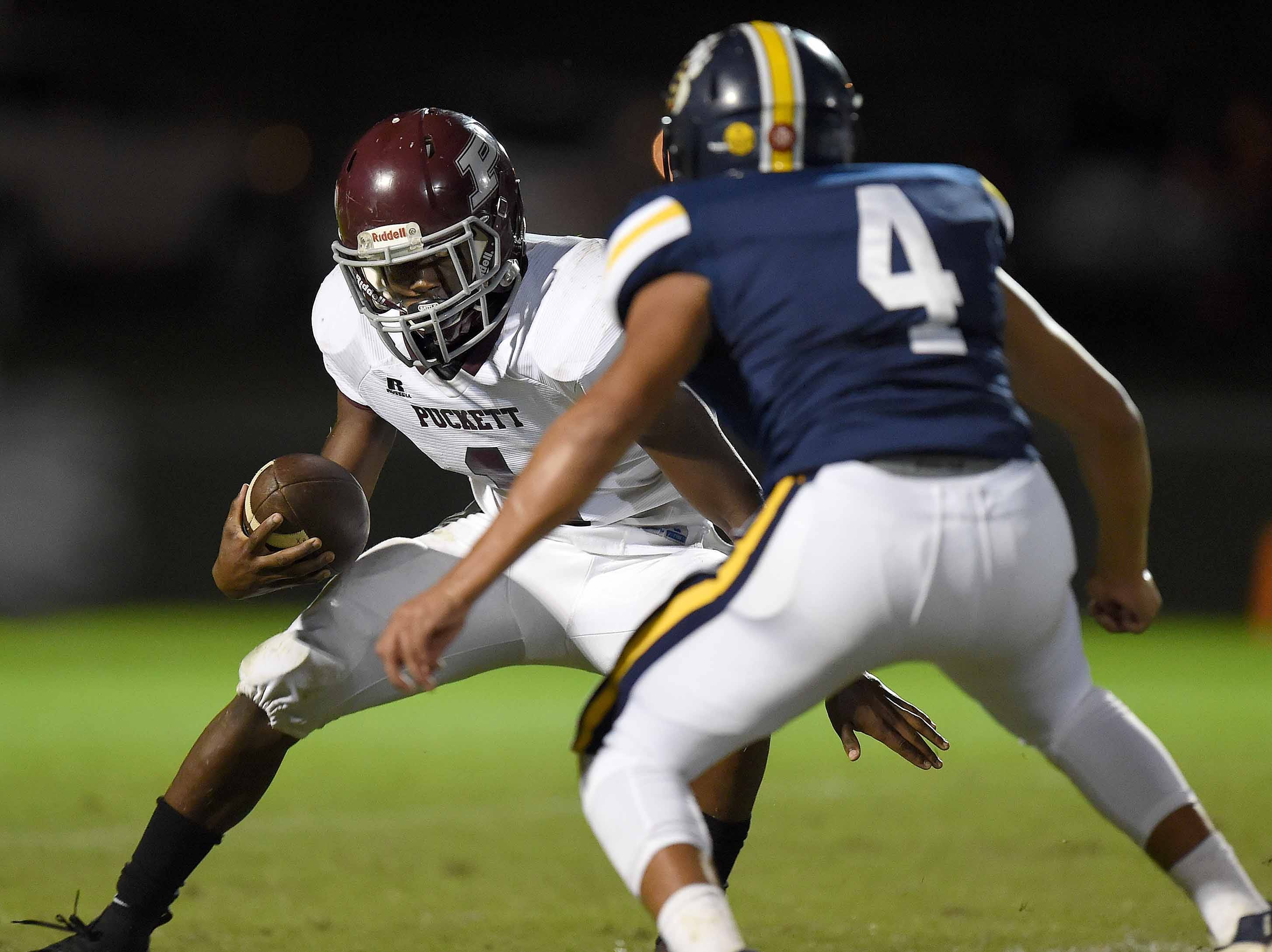 Puckett quarterback Ty'vez Tate (1) tries to get by St. Joseph's Stephen Wolf (4) on Friday, October 19, 2018, at St. Joseph Catholic School in Madison, Miss.