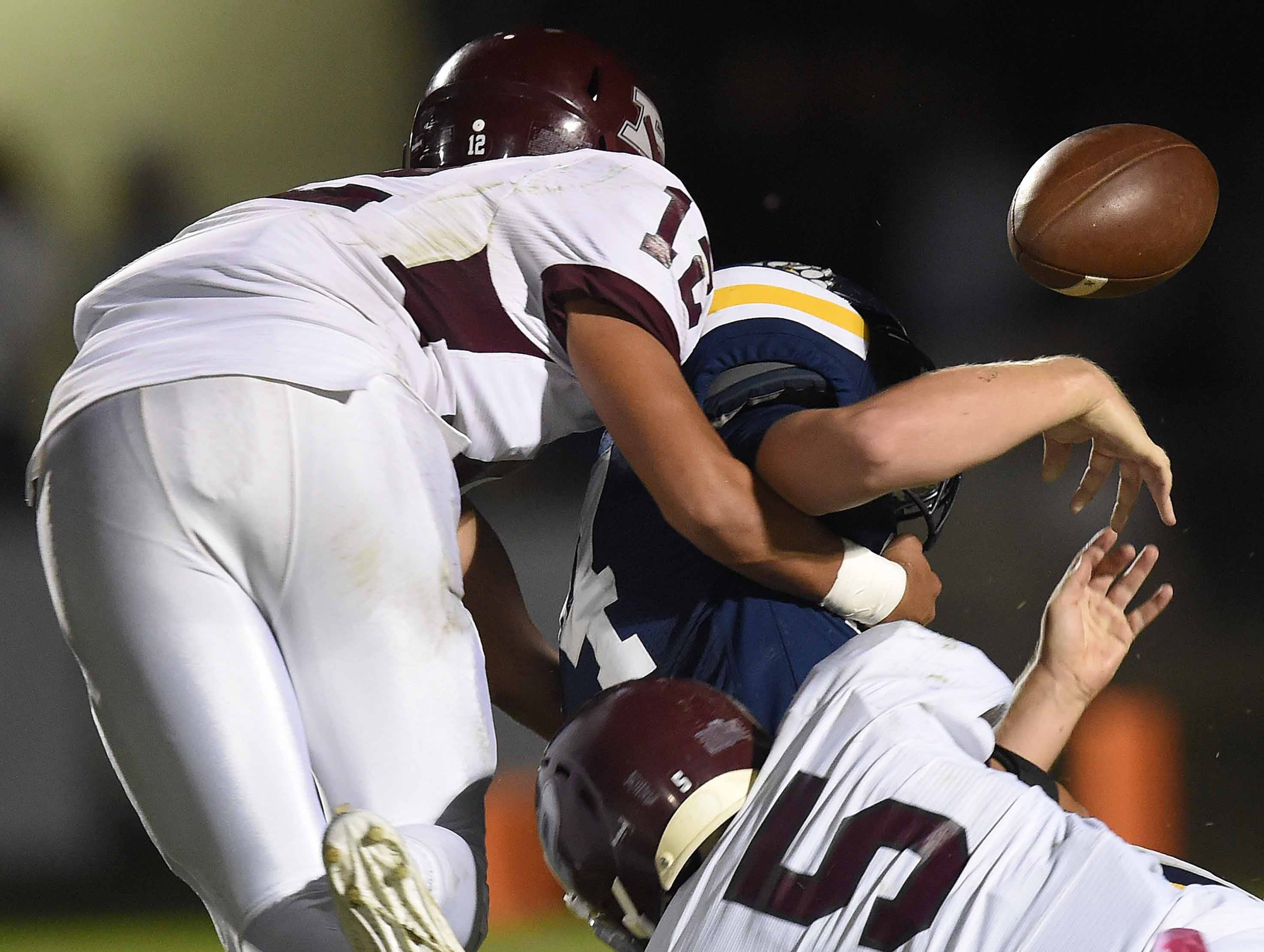 Puckett defenders Price Tullos (12) and Josh Maples (5) force a fumble by St. Joseph's Chandler Thornhill on Friday, October 19, 2018, at St. Joseph Catholic School in Madison, Miss.