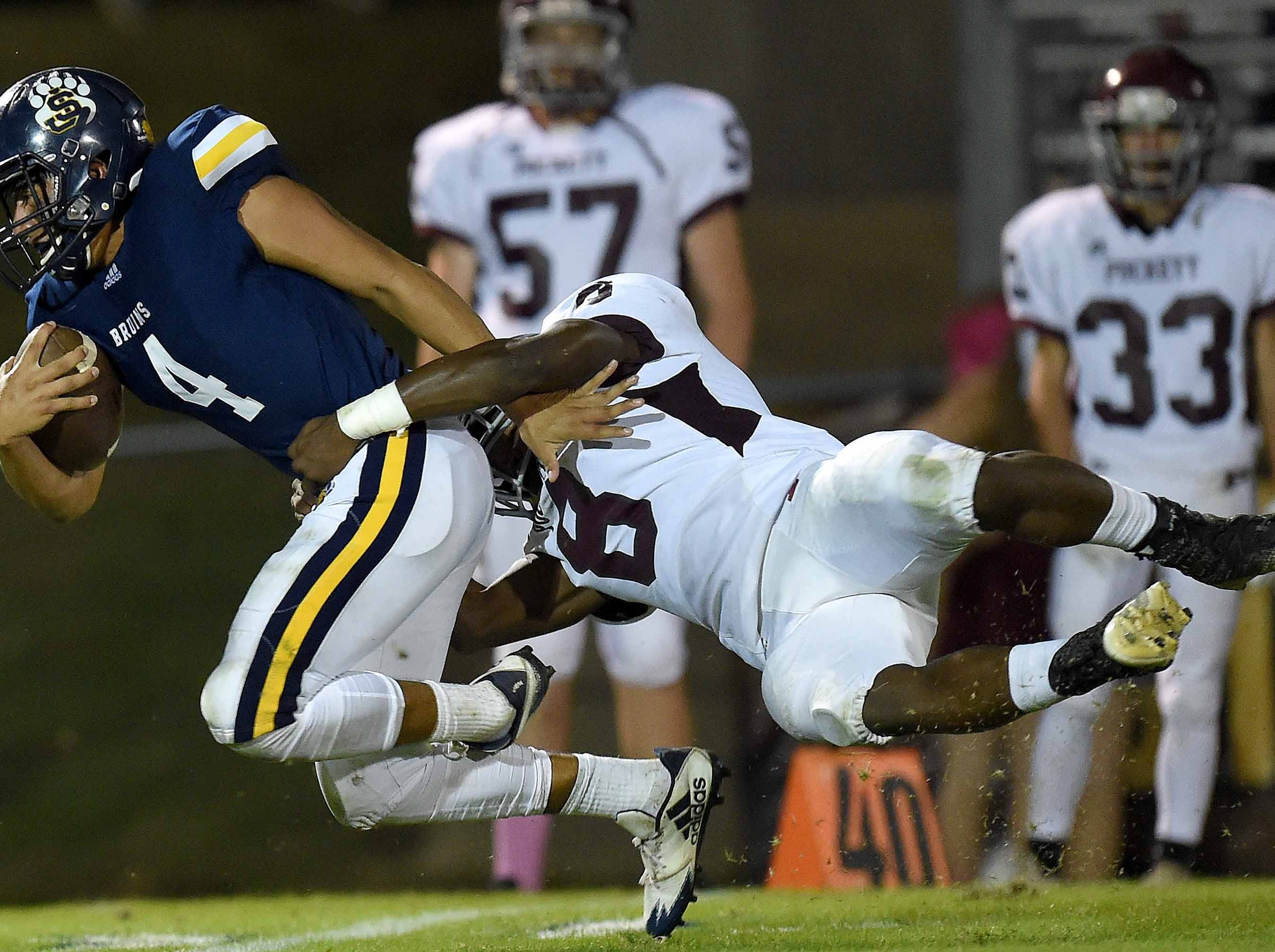 St. Joseph's Stephen Wolf (4) is tackled by Puckett's Omar Easterling (8) on Friday, October 19, 2018, at St. Joseph Catholic School in Madison, Miss.