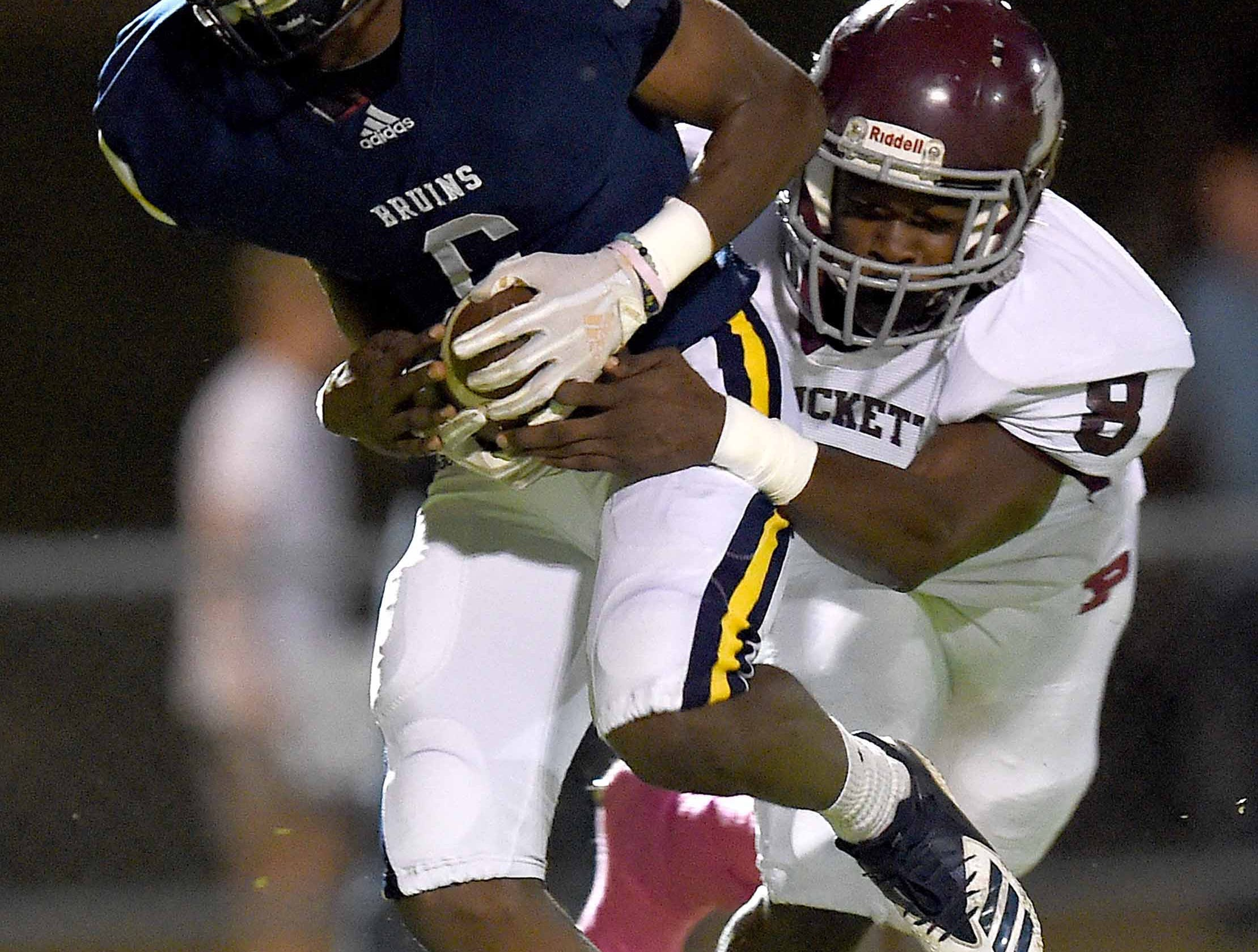 St. Joseph's Kiland Harrison (6) is tackled by Puckett's Omar Easterling (8) on Friday, October 19, 2018, at St. Joseph Catholic School in Madison, Miss.