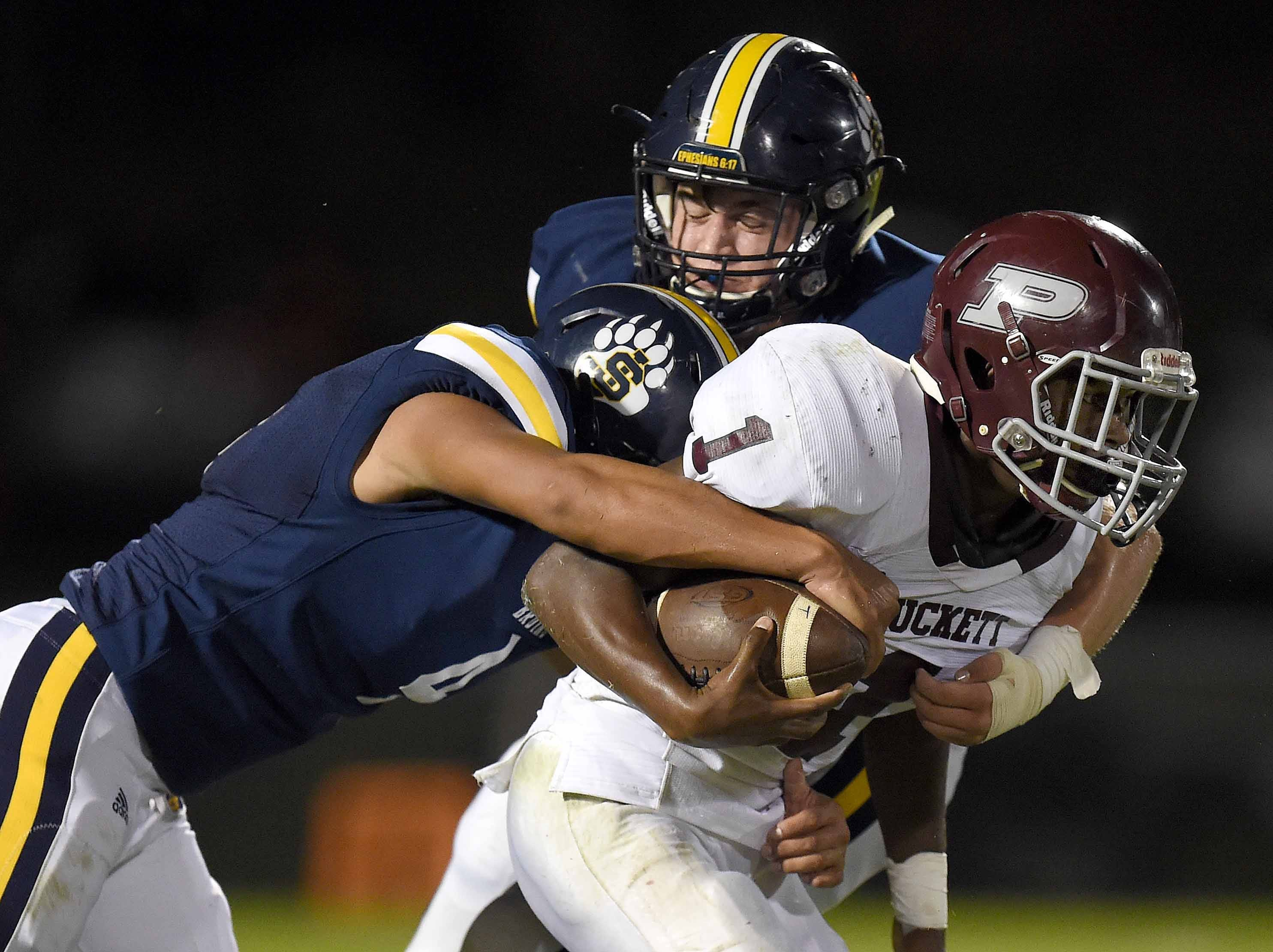 The St. Joseph defense tackles Puckett's Ty'vez Tate (1) on Friday, October 19, 2018, at St. Joseph Catholic School in Madison, Miss.