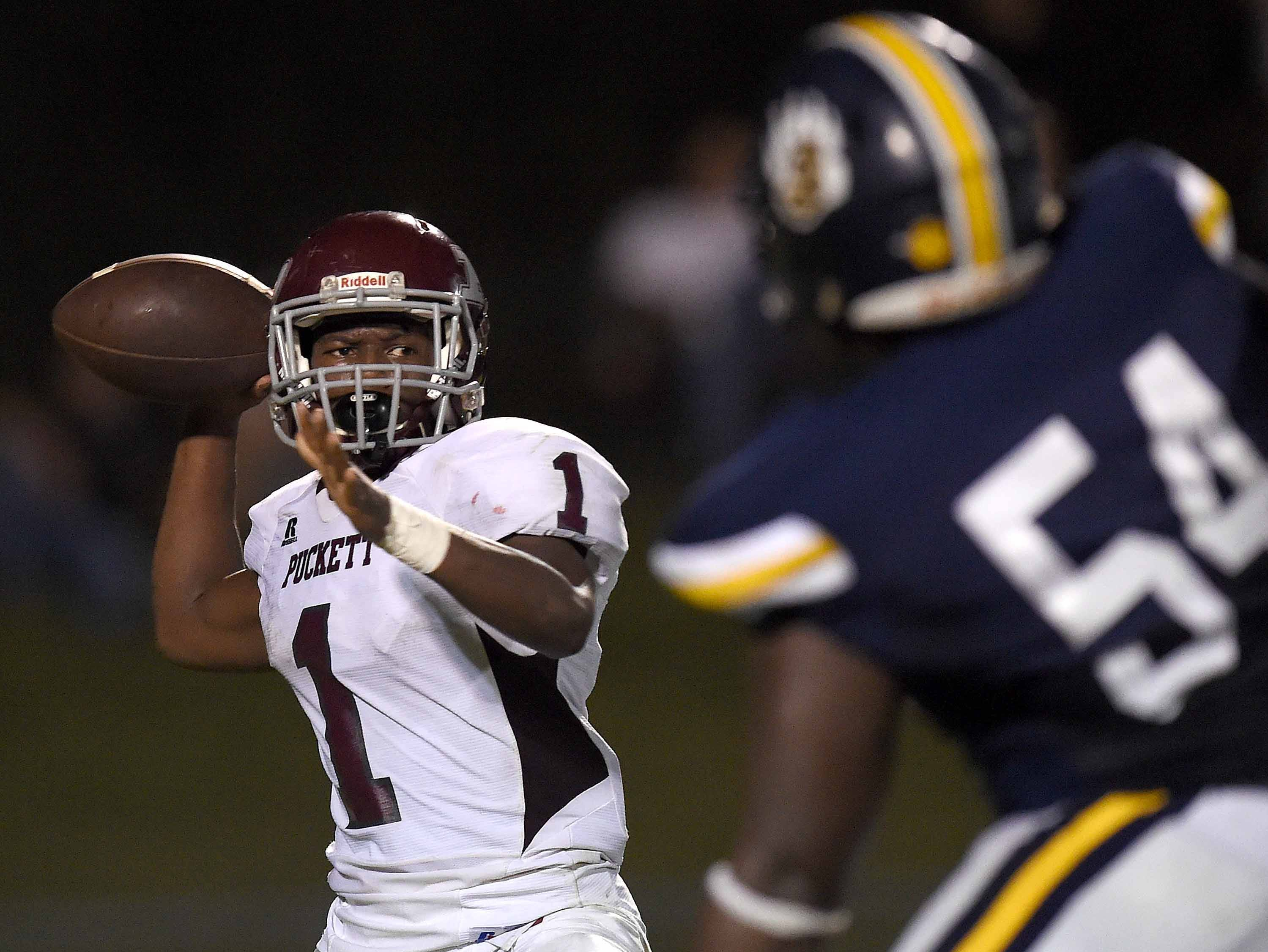 Puckett quarterback Ty'vez Tate (1) looks to throw over the pass rush by St. Joseph's Jaden Coleman (54) on Friday, October 19, 2018, at St. Joseph Catholic School in Madison, Miss.