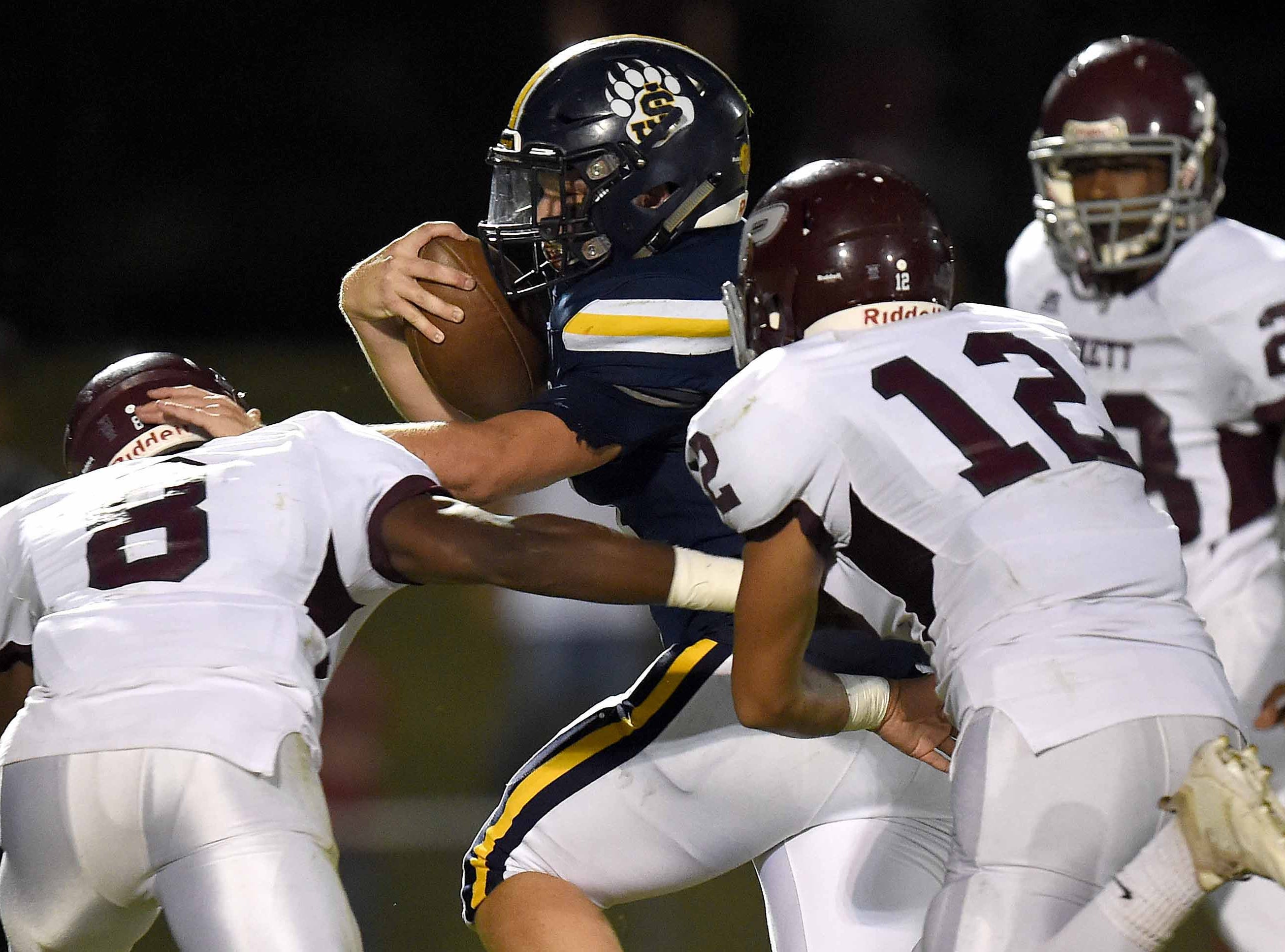 St. Joseph's Chandler Thornhill (24) carries the ball high and tight as he runs through a crowd of Puckett Wolves on Friday, October 19, 2018, at St. Joseph Catholic School in Madison, Miss.