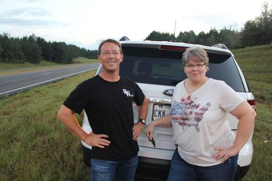 Boyd Williams, left, of Meridian, and Sandra Smith, of Quitman, stand near the spot where Williams' airplane came to rest Oct. 5 on Highway 45 in Clarke County. Williams ditched his plane to avoid hitting Smith's Ford Explorer during an emergency landing after his engine stalled at 3,500 feet.