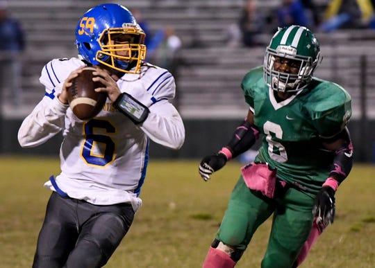 Westview's Ty Simpson looks to pass the ball to a receiver as Bolivar's Jar Lewis chases him down during their game, Friday, October 19. Bolivar defeated Westview, 52-31.