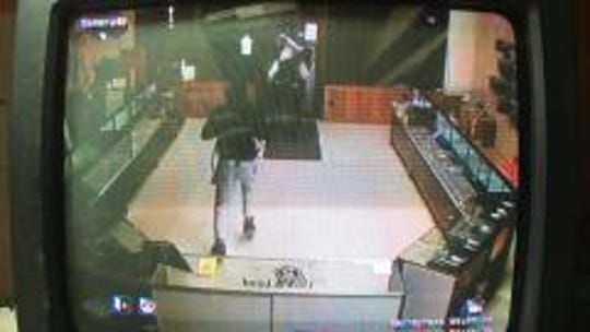 Three individuals broke in to Talley's Lock and Load early Saturday morning, taking 16 handguns. Police are asking the public for help in identifying the thieves.