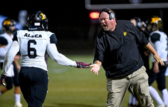 Steve Mathis high-fives Peabody's Jasper Albea (6) when Albea walks off the field in a TSSAA football game between TCA and Peabody High School at Trinity Christian Academy in Jackson, Tenn., on Friday, Oct. 19, 2018.