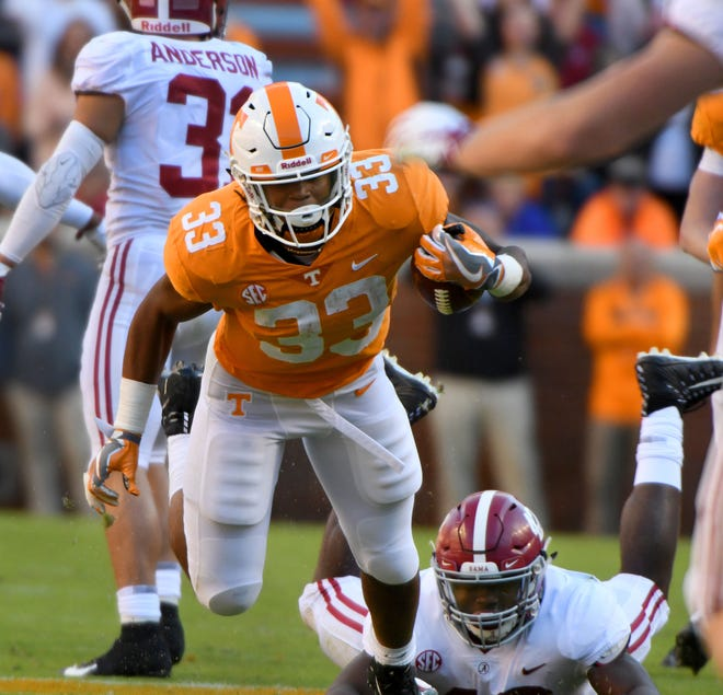 Tennessee running back Jeremy Banks (33) stumbles and drops an onside kick during first half action against Alabama Saturday, October 20, 2018 at Neyland Stadium in Knoxville, Tenn.