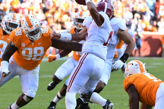 \aTennessee defensive lineman Alexis Johnson Jr. (98) makes Alabama quarterback Tua Tagovailoa (13) scramble  during first half action Saturday, October 20, 2018 at Neyland Stadium in Knoxville, Tenn.