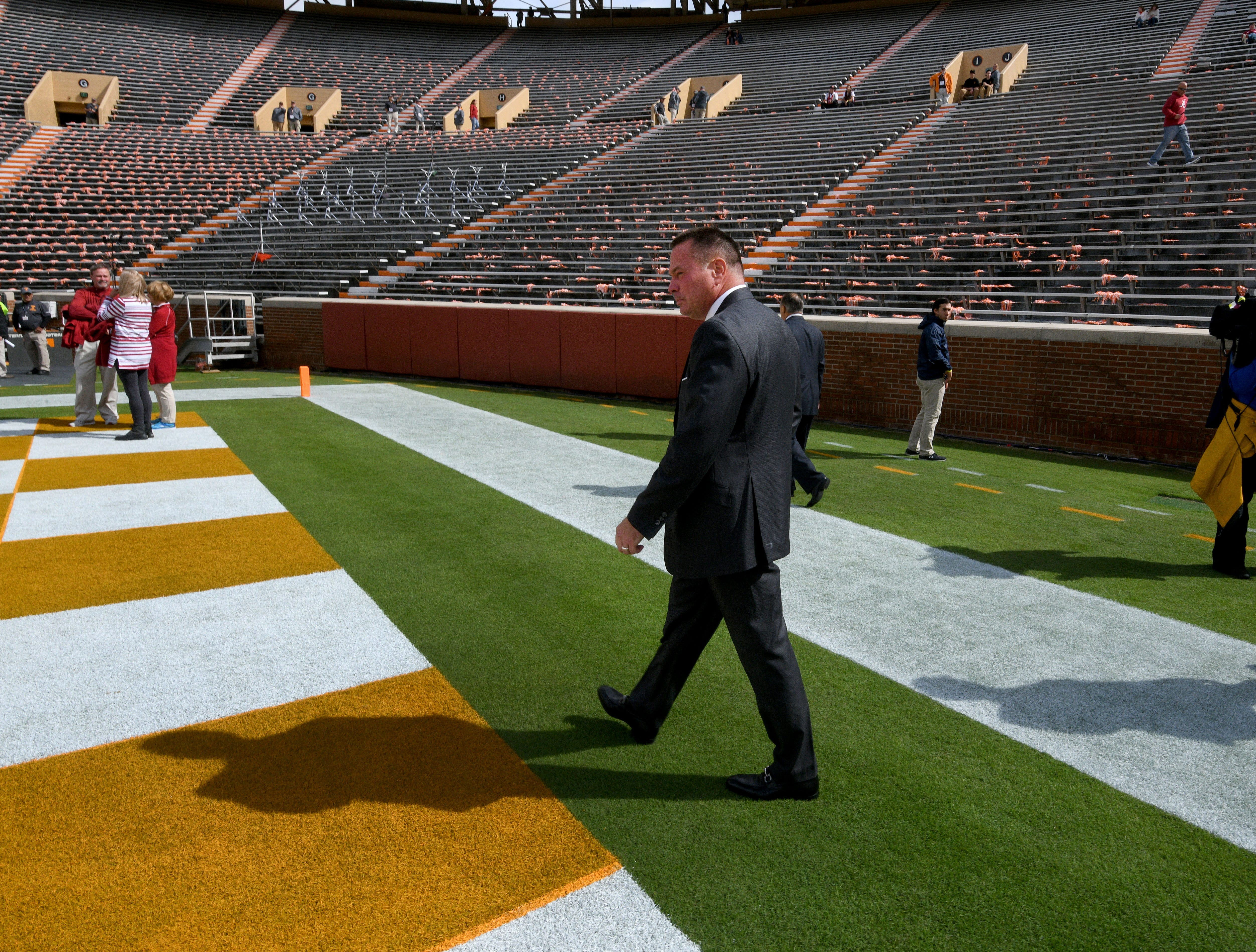 Alabama analyst Butch Jones walks onto the field wearing an Alabama tie before the against Tennessee game Saturday, October 20, 2018 at Neyland Stadium in Knoxville, Tenn.