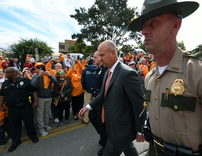 Tennessee coach Jeremy Pruitt, second from right, leads the Vol Walk on Saturday.