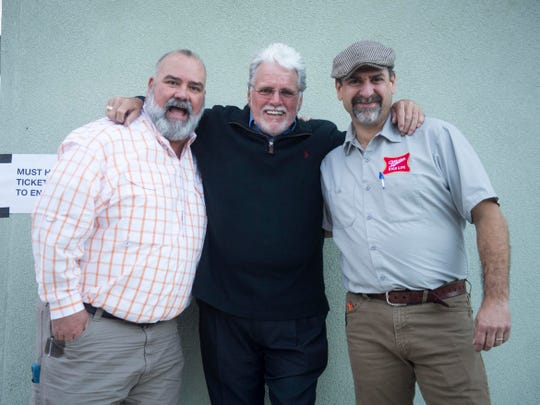 The Corner Lounge owners John Harbison, left, and Steve Brandon with Con Hunley on Friday, October 19, 2018.