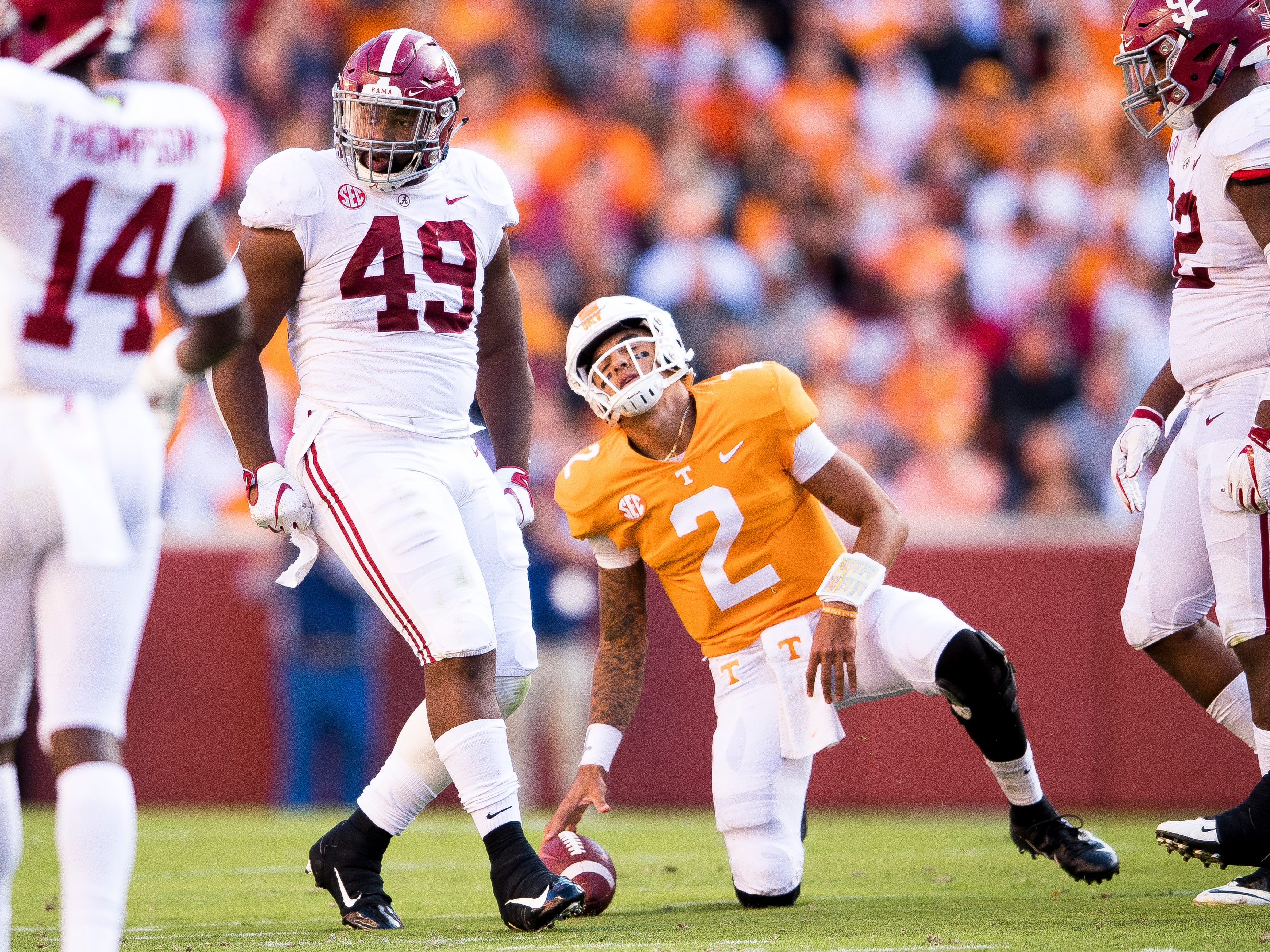 Tennessee quarterback Jarrett Guarantano (2) grimaces as he gets up after being sacked by Alabama defensive lineman Isaiah Buggs (49) during the Tennessee Volunteers' game against Alabama in Neyland Stadium on Saturday, October 20, 2018.