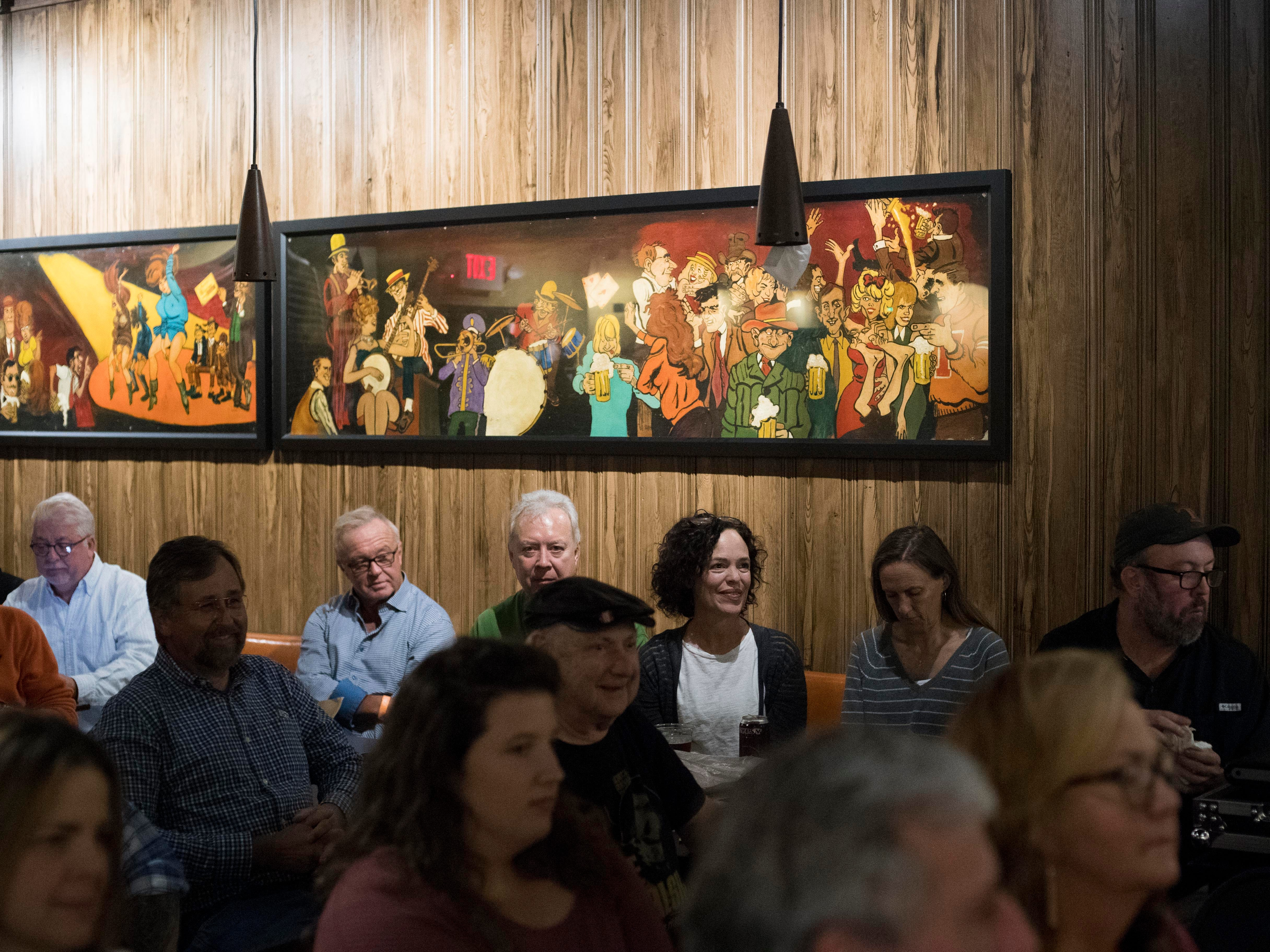 Guests pack The Corner Lounge for Con Hunley's return to The Corner Lounge on Friday, October 19, 2018.