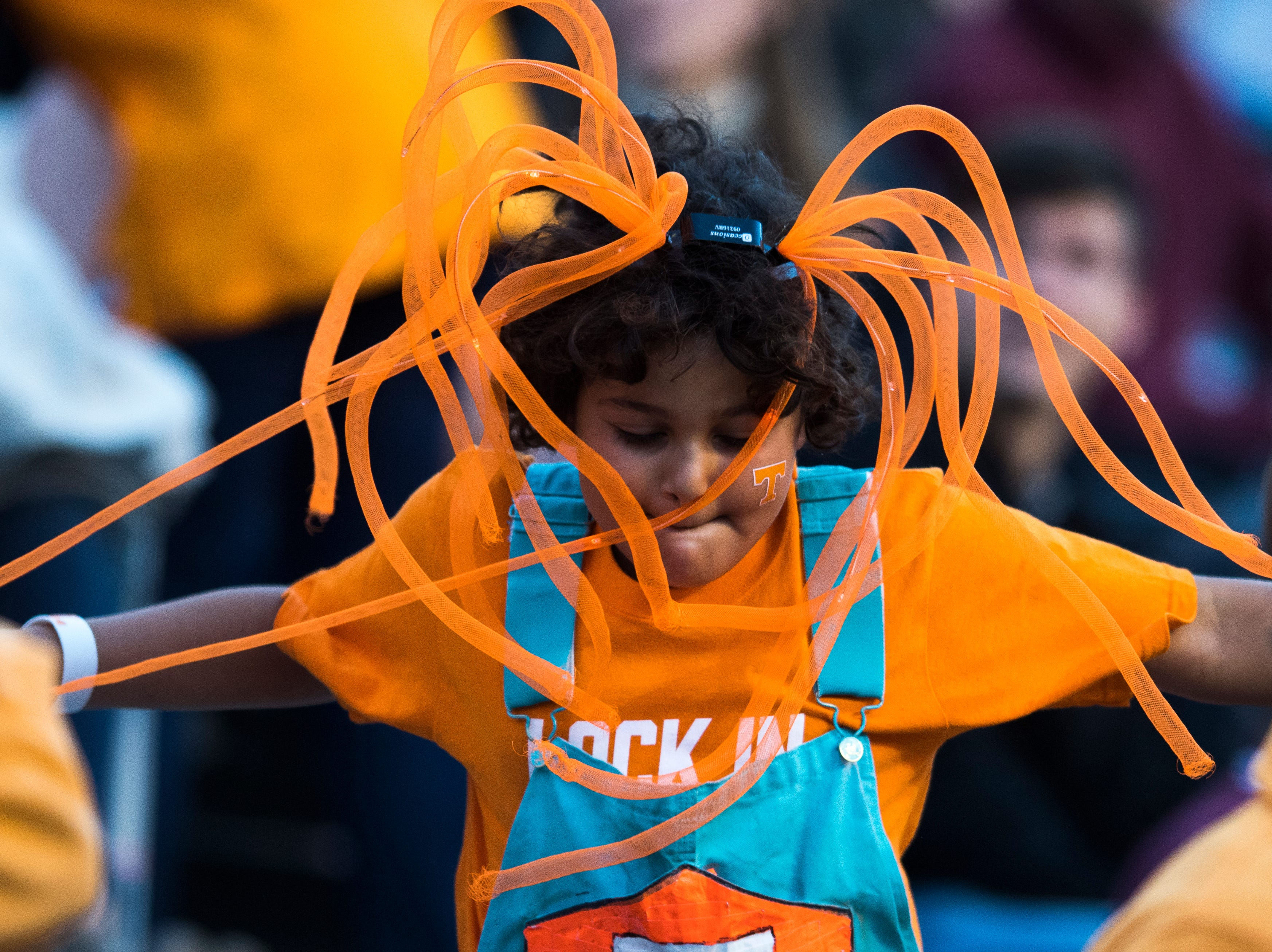 A young Tennessee fan dances in the stands during a game between Tennessee and Alabama at Neyland Stadium in Knoxville, Tennessee on Saturday, October 20, 2018.