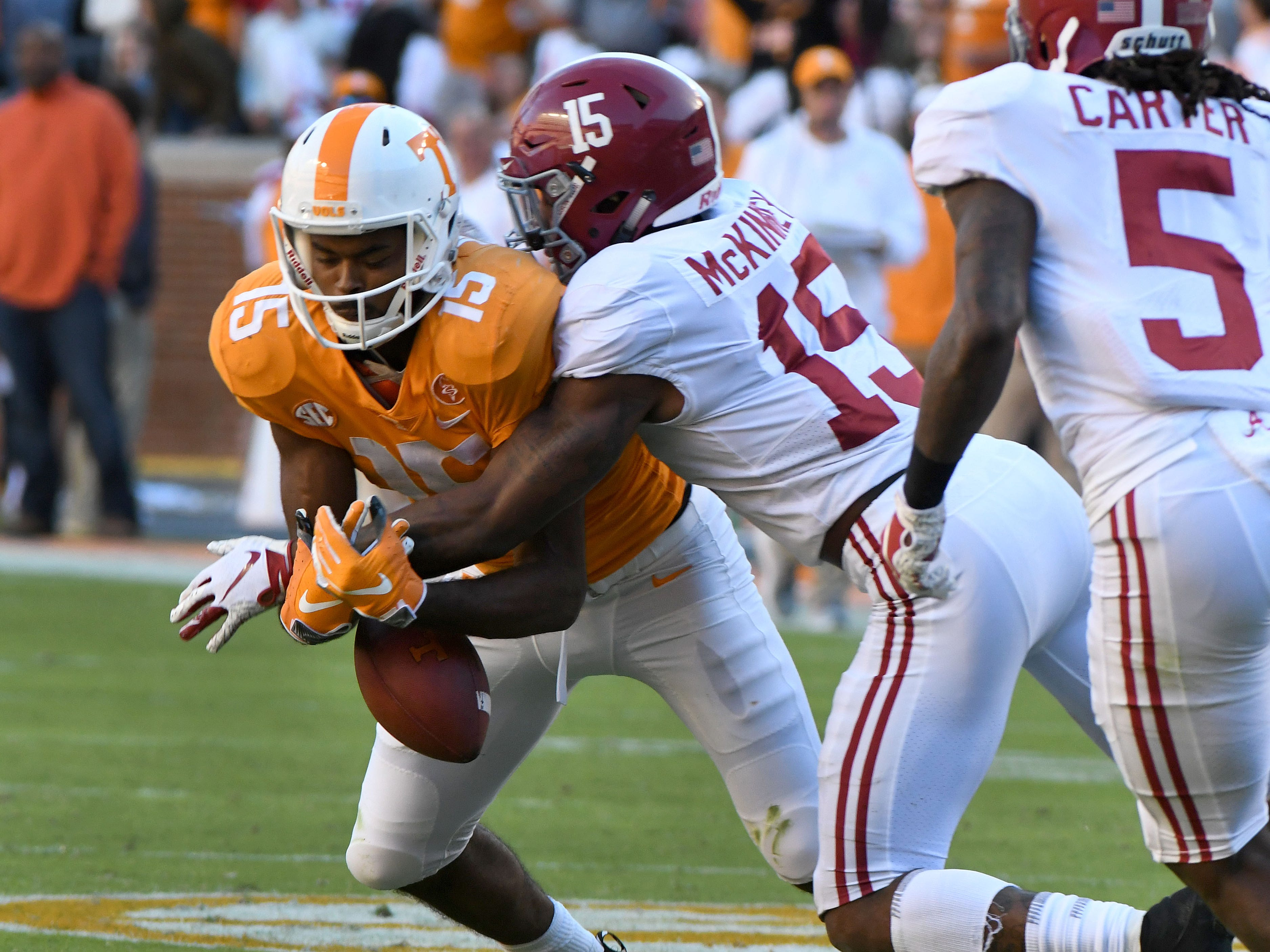 Tennessee wide receiver Jauan Jennings (15) has a pass stripped away by Alabama defensive back Xavier McKinney (15) during first half action Saturday, October 20, 2018 at Neyland Stadium in Knoxville, Tenn.