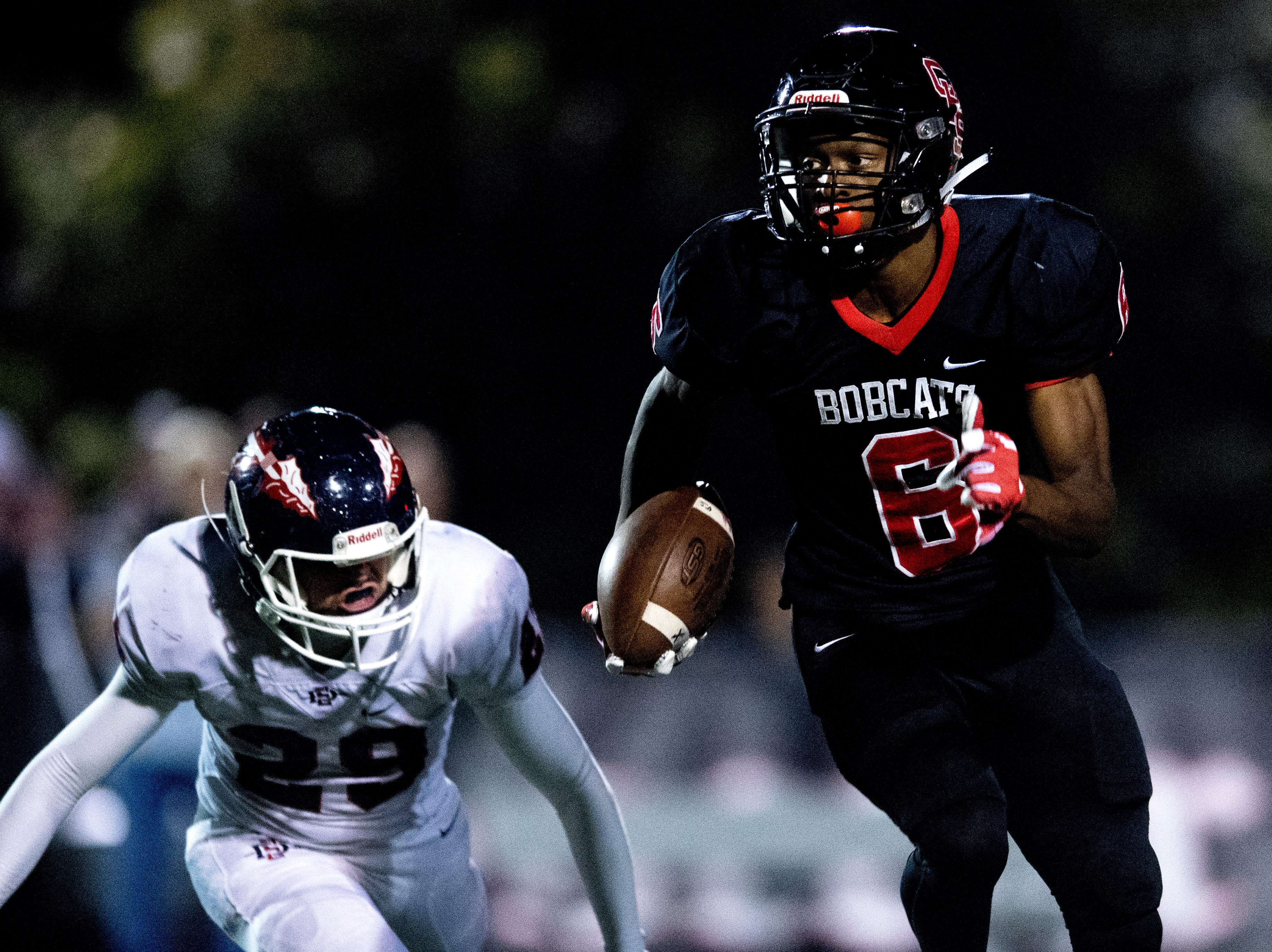 Central's Demetrien Johnson (6) runs with the ball as South-Doyle's Isaac Hamilton (29) pursues him during a football game between Central and South-Doyle at Central High School in Knoxville, Tennessee on Friday, October 19, 2018.