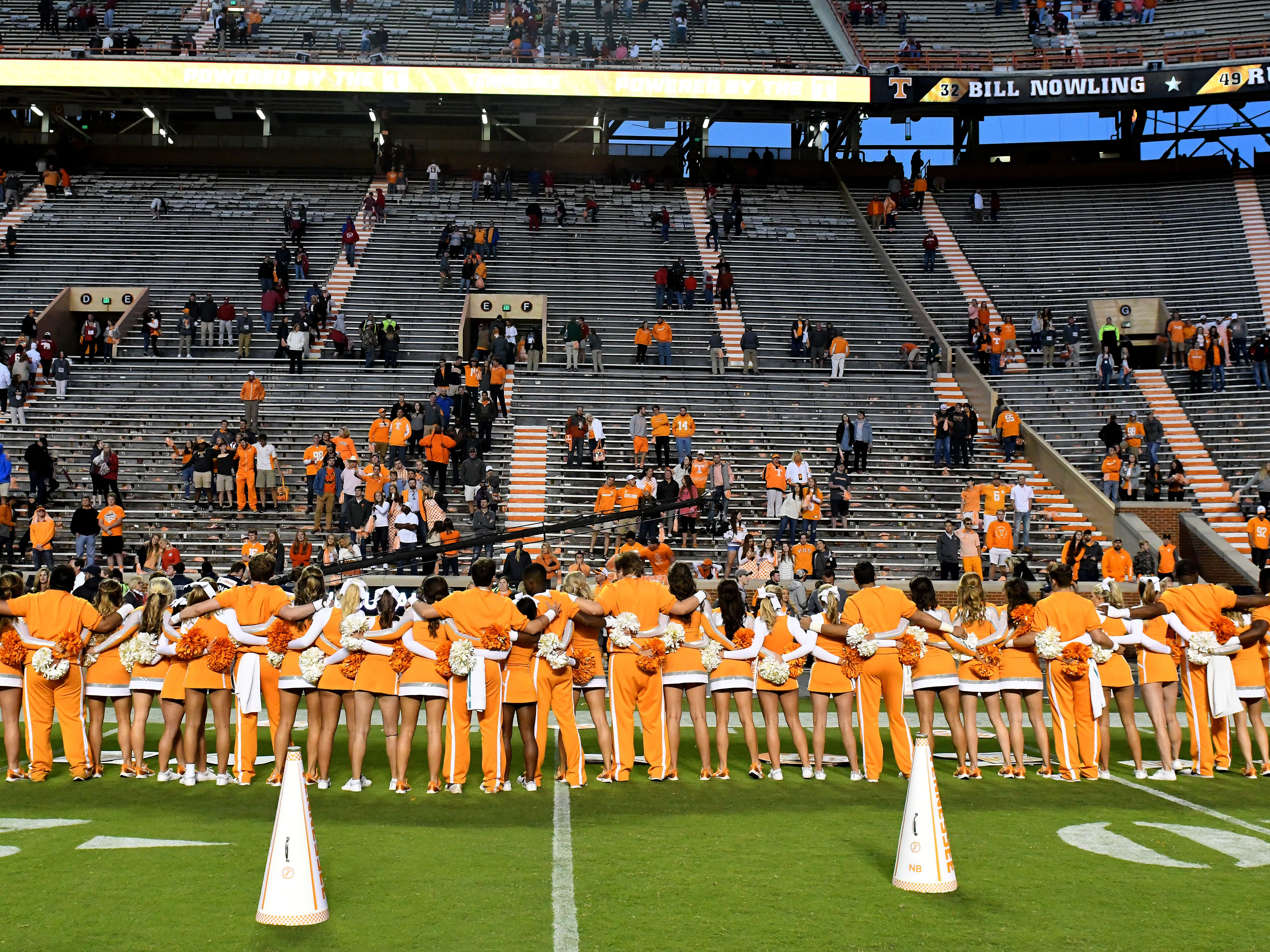 The Tennessee cheer squad signs to the Tennessee Waltz to an almost empty stadium after Alabama won 58-21 Saturday, October 20, 2018 at Neyland Stadium in Knoxville, Tenn.