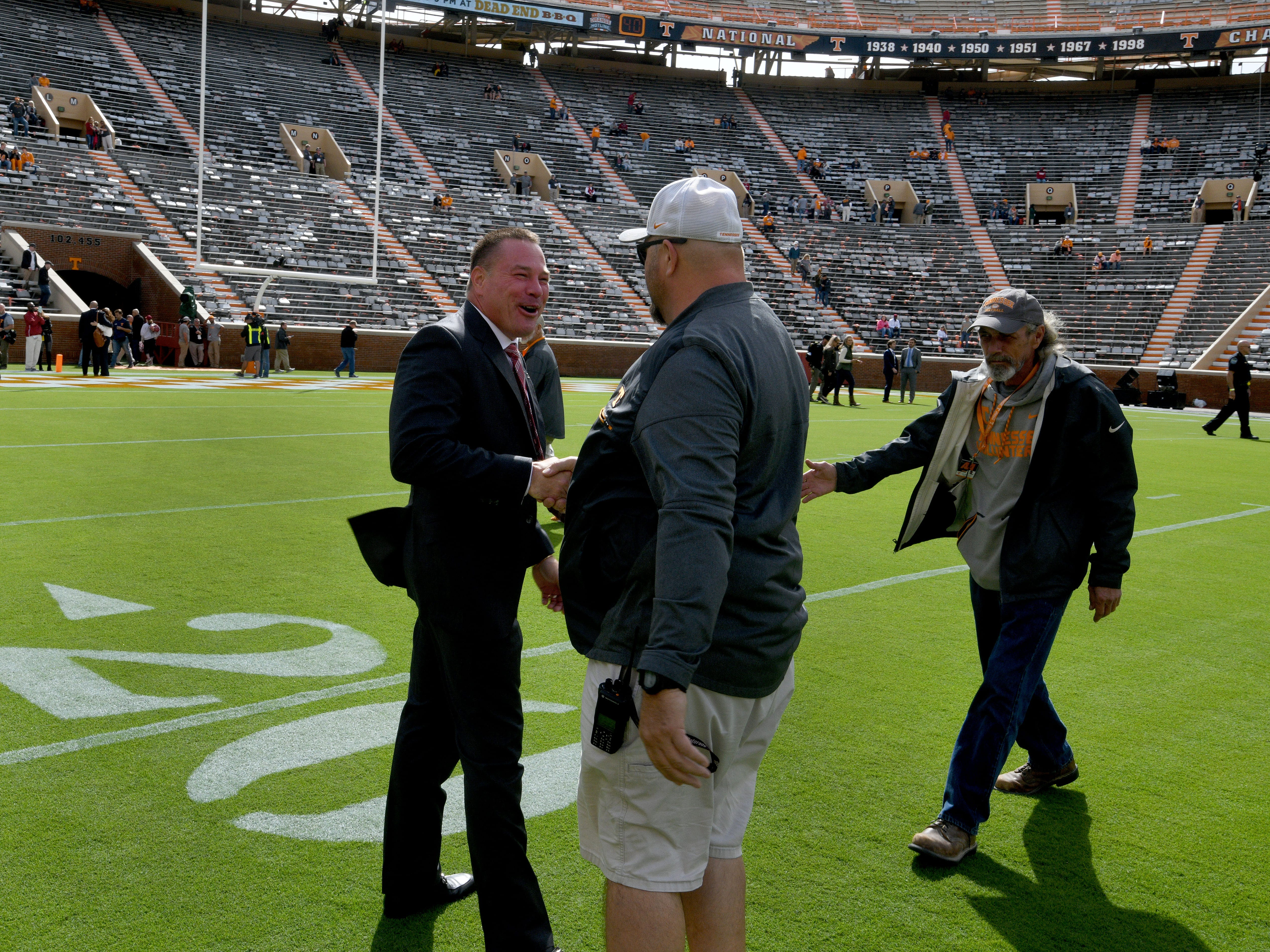 Alabama analyst Butch Jones greets former staff before the Tennessee game Saturday, October 20, 2018 at Neyland Stadium in Knoxville, Tenn.