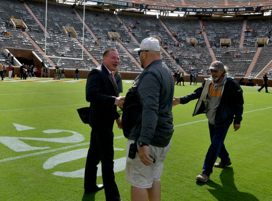 Alabama analyst Butch Jones greets former staff before the Tennessee game Saturday.