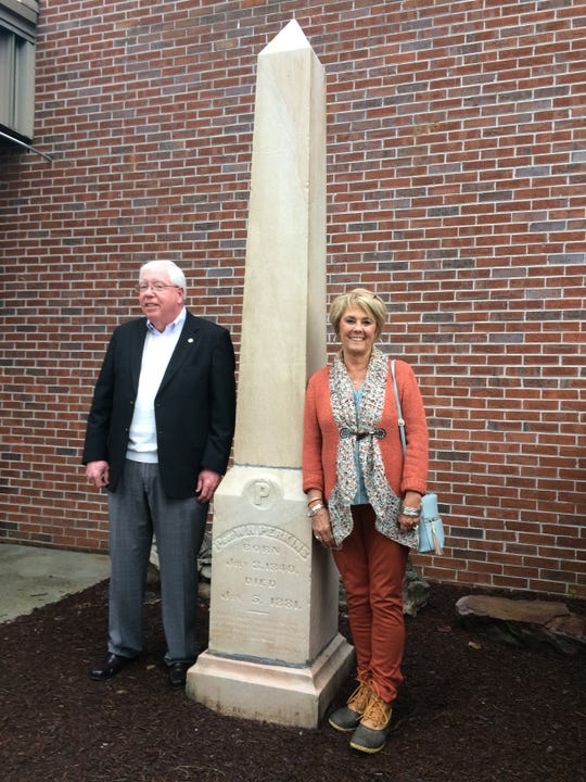 Knox County District 7 Commissioner Charlie Busler and Patti Bounds, District 7 representative on the Knox County School Board, stand Saturday, Oct. 20, at the statue honoring pioneering Powell educator W.H. Perkins.