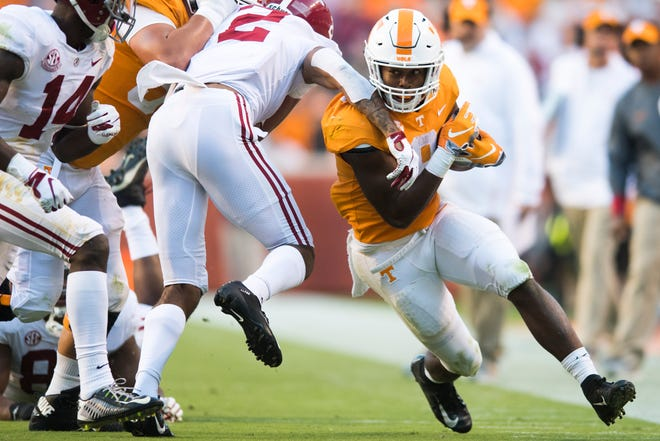 Tennessee running back Ty Chandler (8) runs along the sideline against Alabama on Saturday.