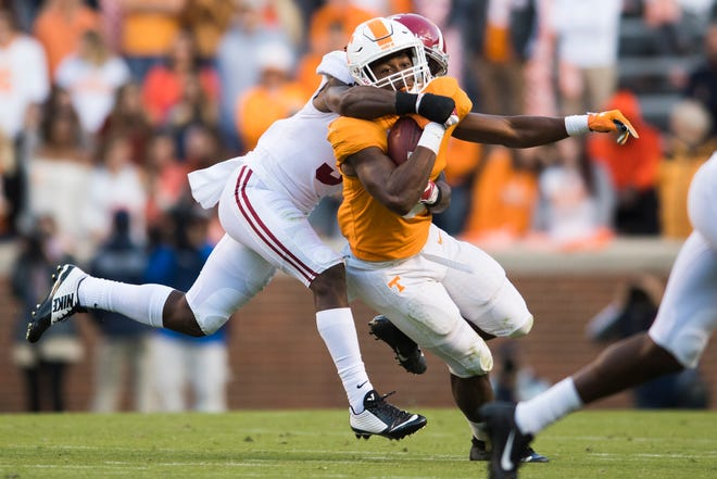 Tennessee running back Ty Chandler (8) is taken down by Alabama defensive back Shyheim Carter (5) during a game between Tennessee and Alabama at Neyland Stadium in Knoxville, Tennessee on Saturday, October 20, 2018.