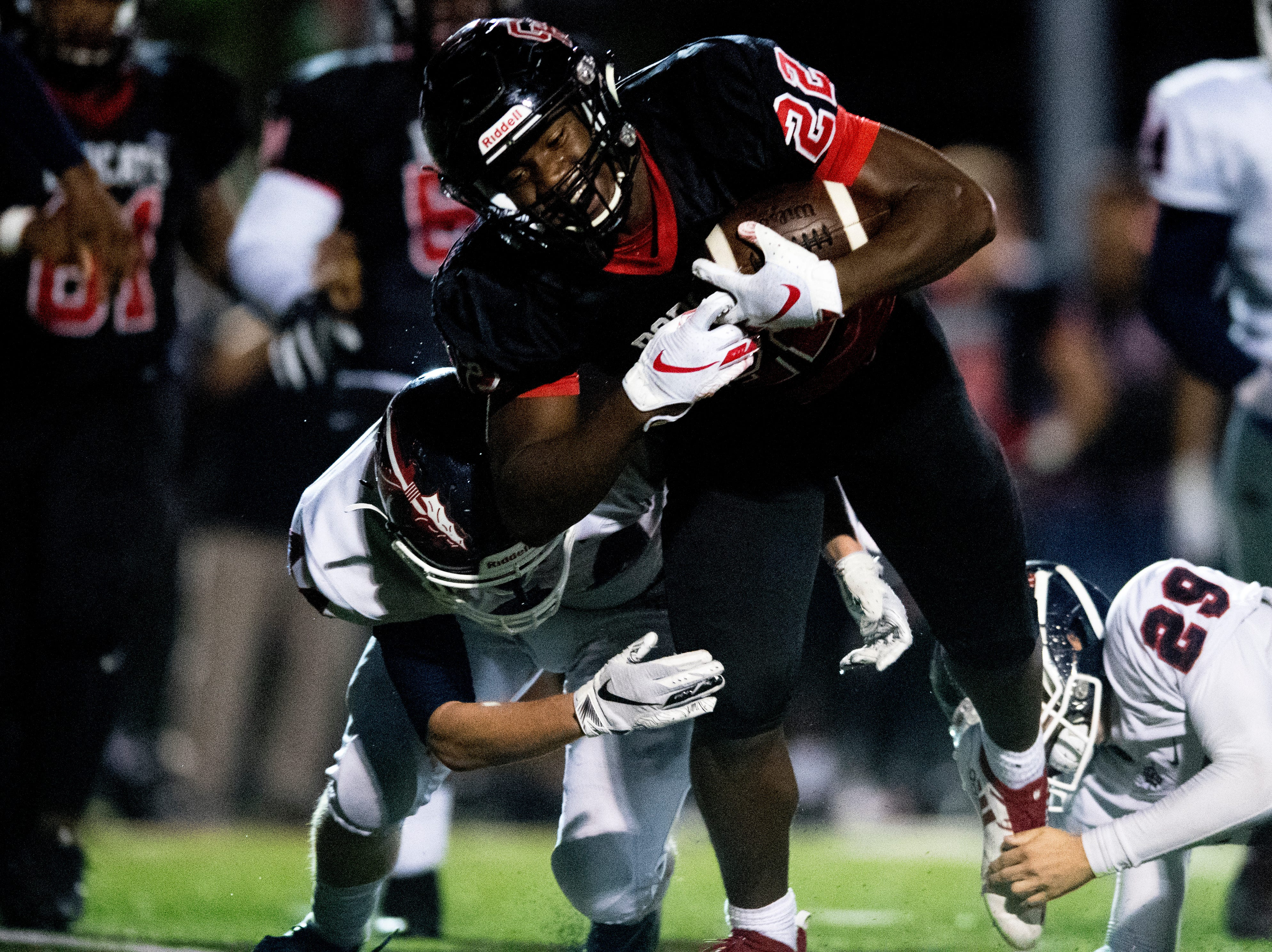 Central's Devone Moss (22) is taken down by South-Doyle's Farrell Scott (44) and South-Doyle's Isaac Hamilton (29) during a football game between Central and South-Doyle at Central High School in Knoxville, Tennessee on Friday, October 19, 2018.