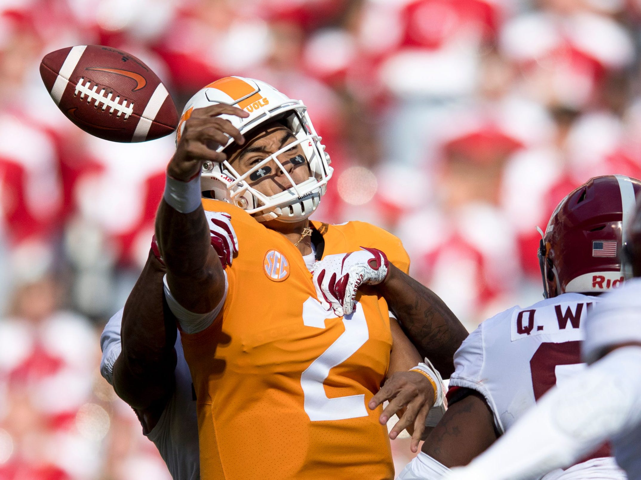 Tennessee quarterback Jarrett Guarantano (2) is sacked by Alabama defensive back Xavier McKinney (15) during a game between Tennessee and Alabama at Neyland Stadium in Knoxville, Tennessee on Saturday, October 20, 2018.