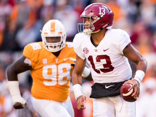 Alabama quarterback Tua Tagovailoa (13) runs with the ball during the Tennessee Volunteers' game against Alabama in Neyland Stadium on Saturday, October 20, 2018.