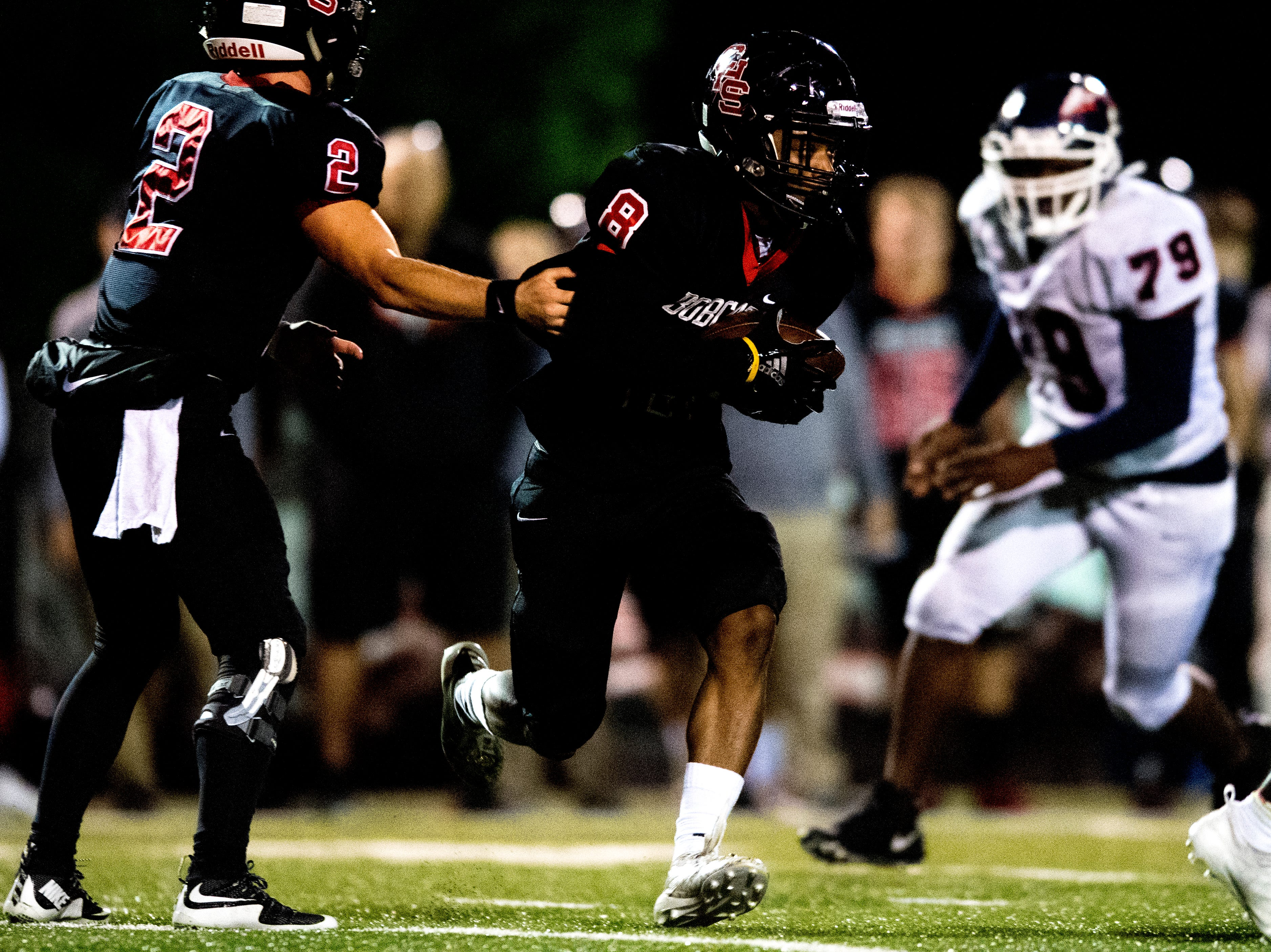 Central's Daunte Holliday (8) is handed the ball by Central's Dakota Fawver (2) during a football game between Central and South-Doyle at Central High School in Knoxville, Tennessee on Friday, October 19, 2018.