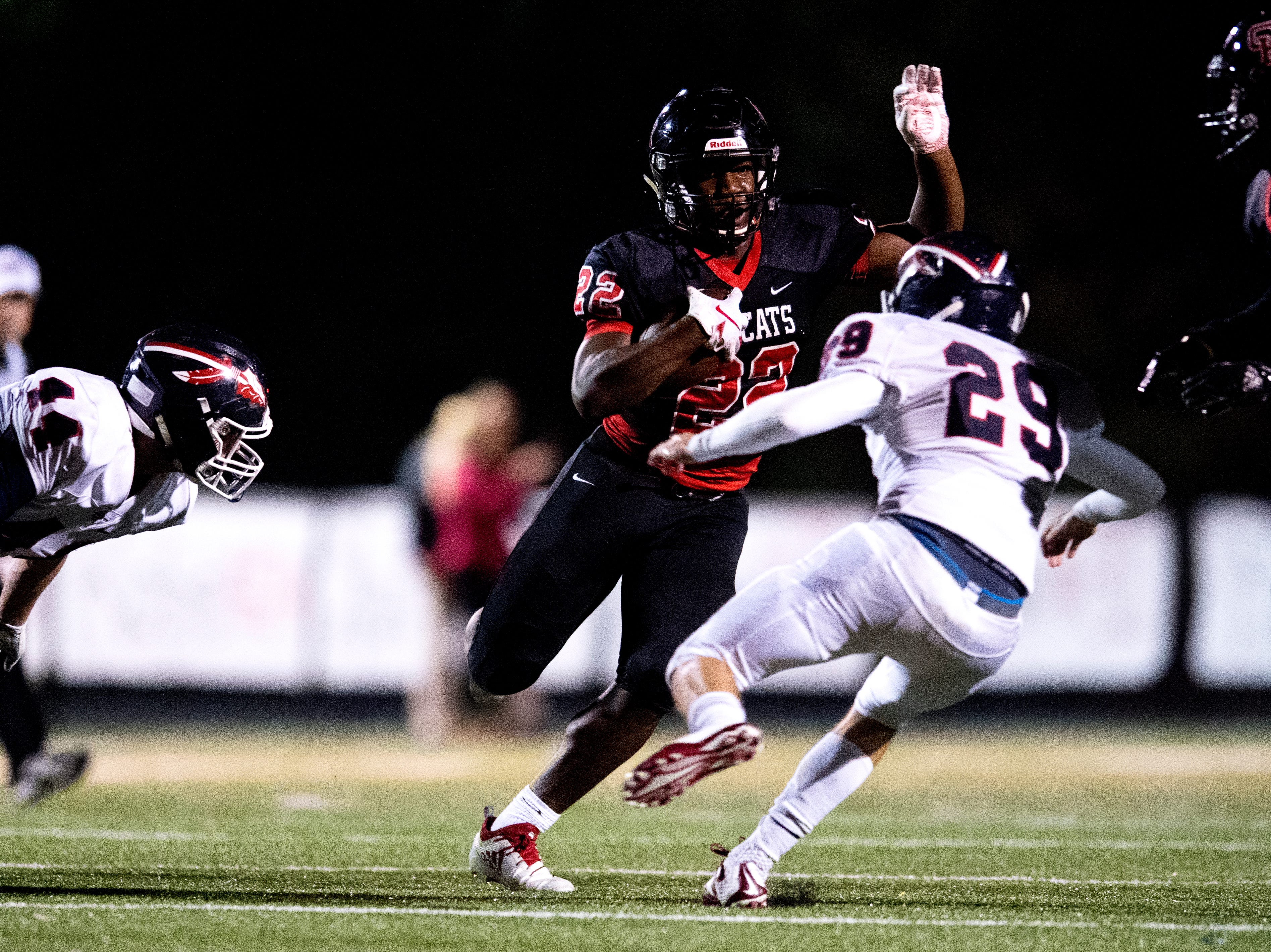 Central's Devone Moss (22) runs with the ball as South-Doyle's Isaac Hamilton (29) defends during a football game between Central and South-Doyle at Central High School in Knoxville, Tennessee on Friday, October 19, 2018.